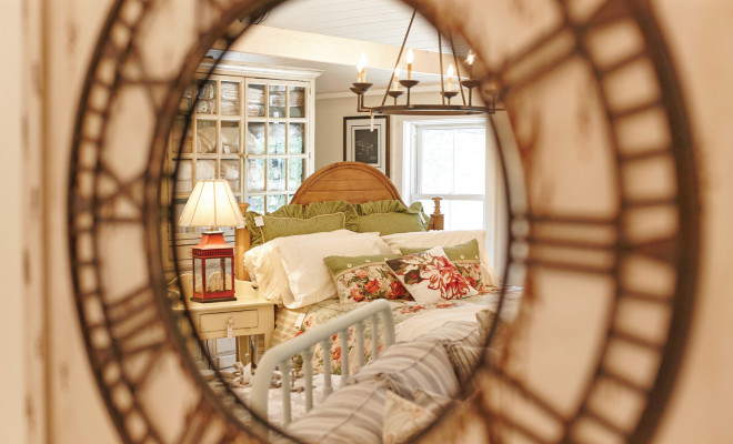 Bedroom setting reflected in mirror at HillTop Interiors